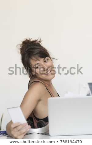 Young And Pretty Startup Worker Using A Moblie Phone Stockfoto © 2Design