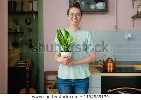 Young girl potting a plant Stock photo © IS2