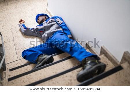 Casco inconsciente manitas primer plano hombre construcción Foto stock © AndreyPopov