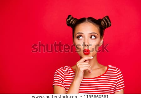 Close up image of young smiling female with red lips holding mob Stock photo © deandrobot