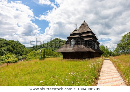 Old wooden church with Carpathians, Ukraine Stock photo © Kotenko