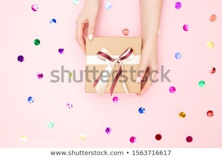 Girl handing a present Stock photo © IS2