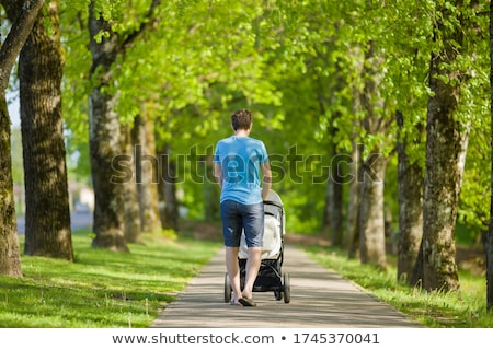 Father pushing pram on pavement Stock photo © IS2