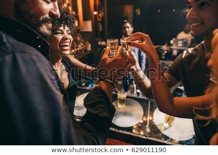 Feliz homem vodka tiro retro Foto stock © studiostoks