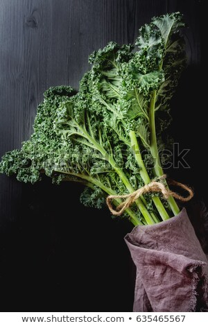 Whole kale leaves in wooden bowl on a table Stock photo © Virgin