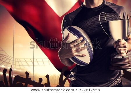 Composite image of midsection of player holding rugby ball Stock photo © wavebreak_media
