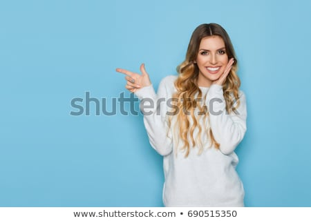 smiling woman in blue sweater stock photo © acidgrey