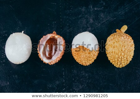 The composition of lychee and peel on a blue background with copy space. Flat lay Stock photo © artjazz