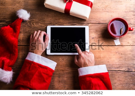 santa claus hats on white wooden desk with blank copy space stock photo © dash