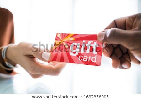 Homem vermelho cartão de presente datilografia laptop Foto stock © AndreyPopov
