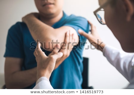Pain in the elbow Stock photo © kalozzolak