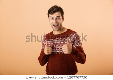 Image of happy man 20s with bristle wearing knitted sweater smil Stock photo © deandrobot