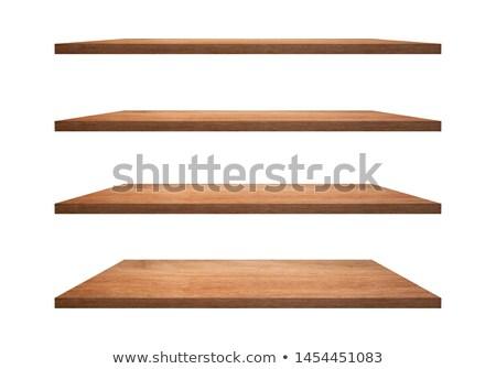 Empty wooden shelves in front of wooden wall Stock photo © karandaev