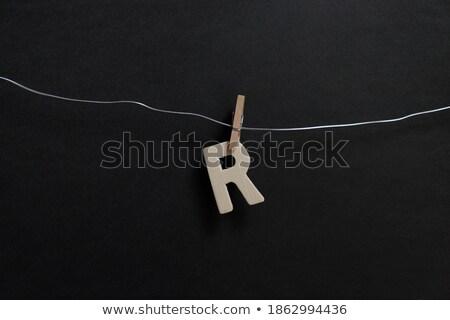 Prendedor de roupa letra r isolado branco carta Foto stock © boggy