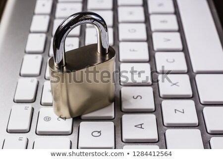 close key lock on keyboard blockchain internet system stock photo © vinnstock