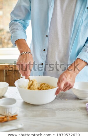 Stock photo: Male hands form with fresh dough on the kitchen