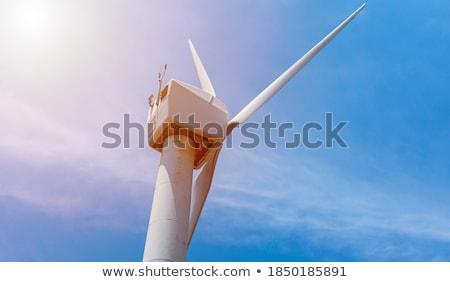 Windmill against cloudy sky with copyspace Stock photo © galitskaya