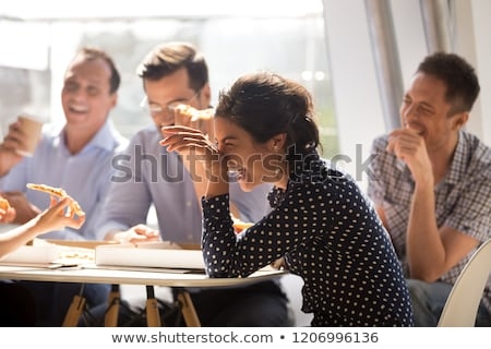 happy friends or team eating at office party Stock photo © dolgachov