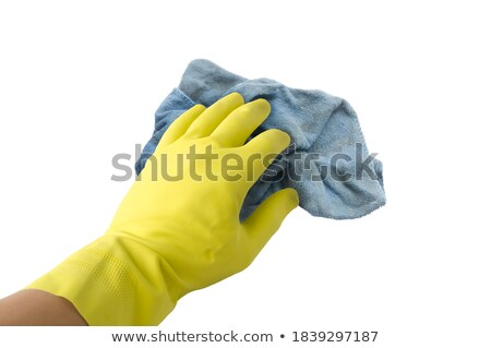Female Janitor Cleaning Table With Blue Rag Stock photo © AndreyPopov