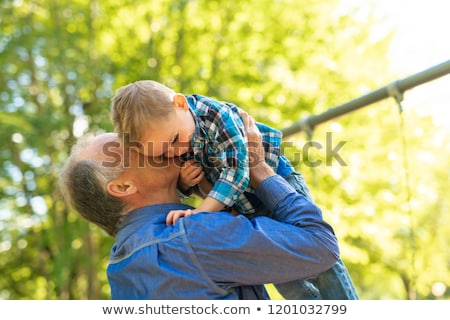 grandfather and littleson having fun in the park Stock photo © Lopolo