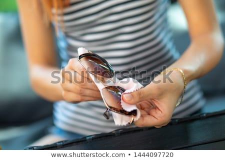 Manos limpieza sol gafas micro fibra Foto stock © adamr