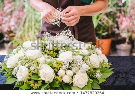 Gardener woman creating grave decoration Stock photo © Kzenon