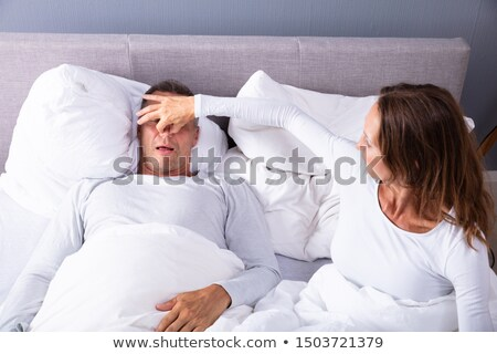 Woman Trying To Stop Man's Snoring With Her Finger Stock photo © AndreyPopov