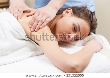 woman lying and having back massage at spa parlor Stock photo © dolgachov