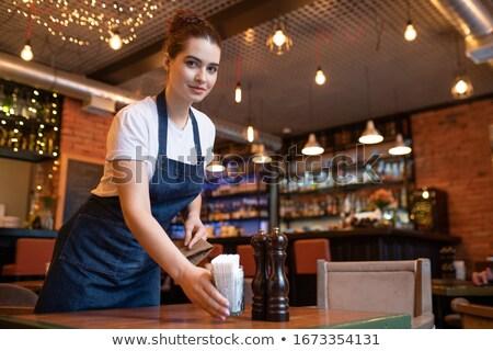 Fiatal derűs barista munkaruha néz görbület Stock fotó © pressmaster