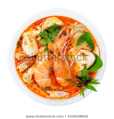 Tom Yum Kung - Red bowl with tasty seafood soup with shrimps lime and oysters, Thai cuisine Stock photo © MarySan