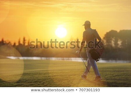 golfer walking on faiway stock photo © lichtmeister