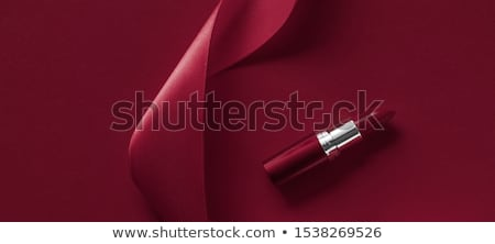 Luxury lipstick and silk ribbon on maroon holiday background, ma Stock photo © Anneleven