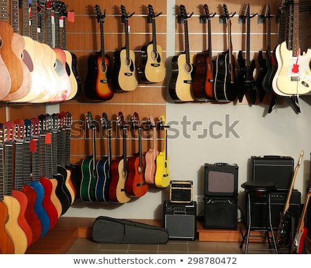 Classic Guitars For Sale In Music Instrument Shop Stock photo © diego_cervo