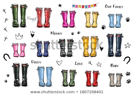 Yellow Rubber Boots On Pink Background Stock photo © AndreyPopov