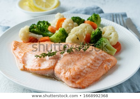 Baked salmon with boiled vegetable Stock photo © furmanphoto
