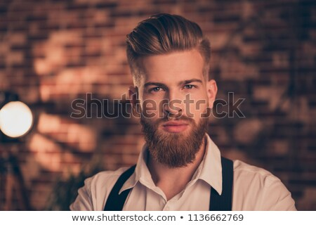 Close up portrait of self assured handsome businessman with stubble, being prosperous business owner Stock photo © vkstudio