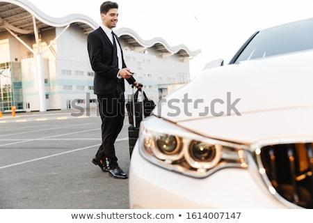 Imagem homem abertura carro alarme remoto Foto stock © deandrobot