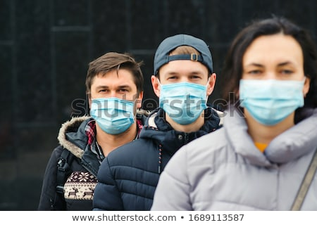 Sick Infected Young Woman Wearing Face Mask Walks on Street In I Stock photo © feverpitch