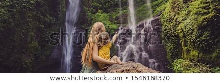 Mather and son at the Sekumpul waterfalls in jungles on Bali island, Indonesia. Bali Travel Concept Stock photo © galitskaya
