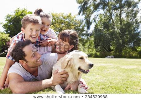 Família feliz golden retriever cão mulher família casa Foto stock © Elnur