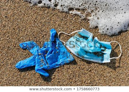 используемый латекс перчатка песок пляж Сток-фото © nito