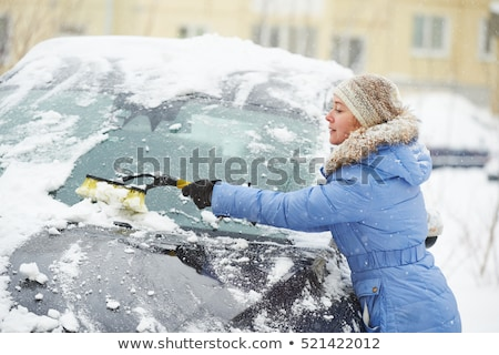 Removing snow from car with a brush Stock photo © galitskaya