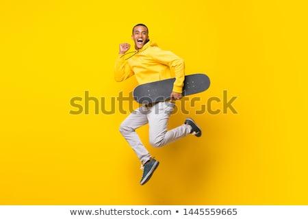 парень · коньки · сидят · счастливым · спортивных · каменные - Сток-фото © paha_l