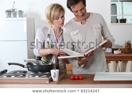Couple cooking together at electric hob Stock photo © photography33
