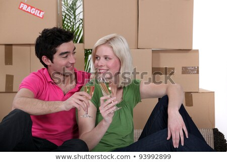 couple having a celebratory drink on moving day stock photo © photography33