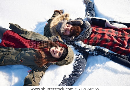 Ski couples lying in the snow Stock photo © photography33