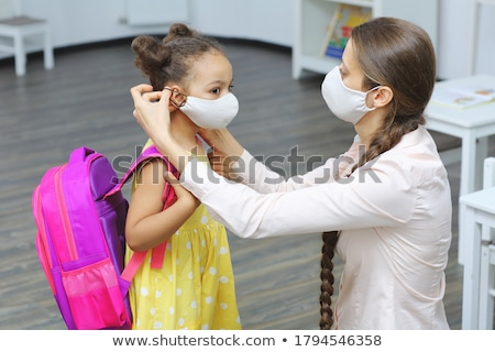 Stock photo: teacher helping a student