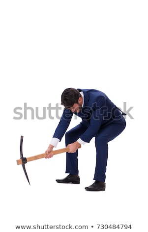 A construction worker digging with a pick axe. Stock photo © photography33