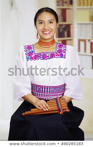 Young Peruvian Woman Playing the Guitar Stock photo © ildi