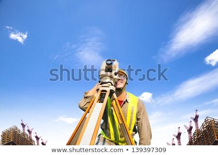 jonge · grond · werk · vrouw · hemel · gebouw - stockfoto © lightpoet